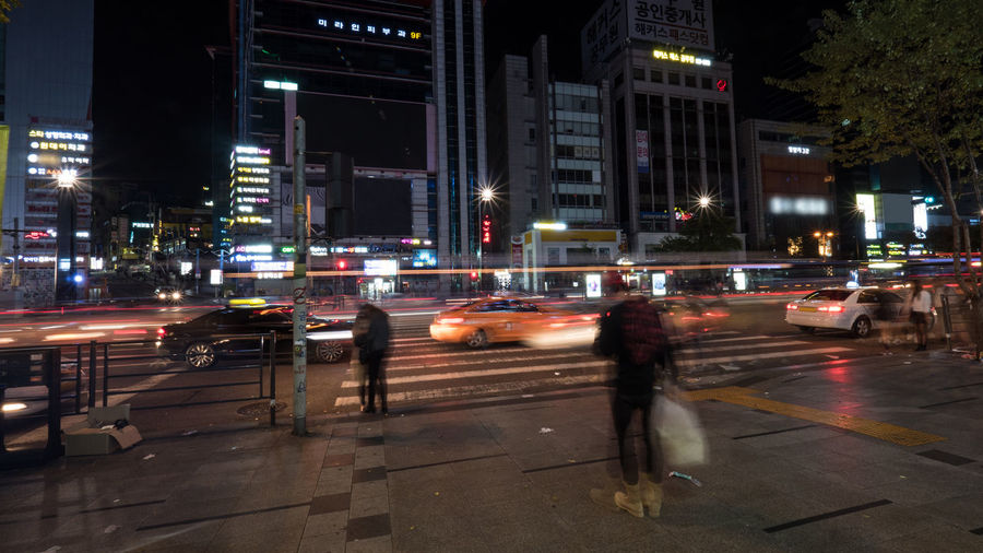 Road traffic and some pedestrians waiting at zebra crossing at night. Shot in motion in Gangnam district of Seoul, South Korea Architecture Auto City City Life City Street Cross Highway Horizontal Illuminated Night Nightlife Outdoors Pedestrian People Person Regulation Road Seoul South Korea Street Traffic Transport