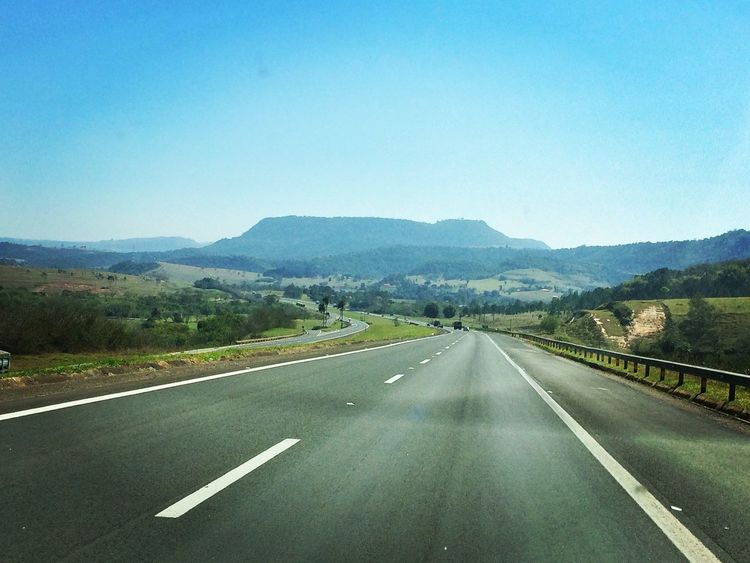 Blue Clear Sky Copy Space Country Road Countryside Day Diminishing Perspective Dividing Line Empty Landscape Long Mountain Mountain Range Nature Outdoors Road Road Marking Solitude Surface Level The Way Forward Tranquil Scene Tranquility Transportation Vanishing Point White Line