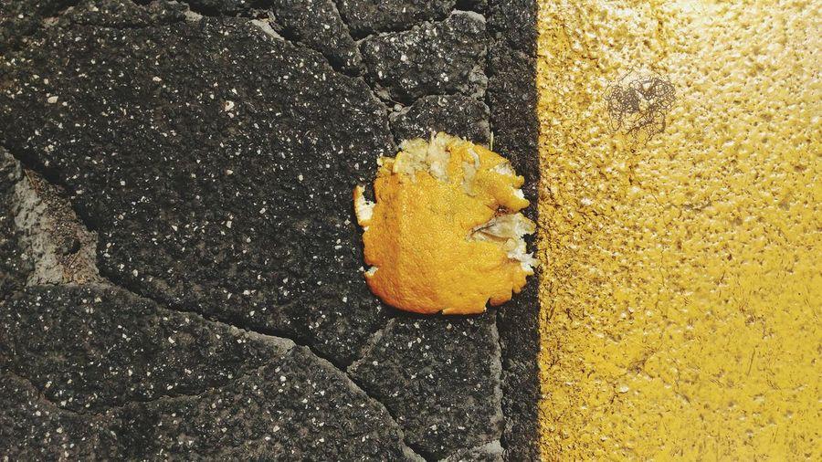 High angle view of orange on yellow wall