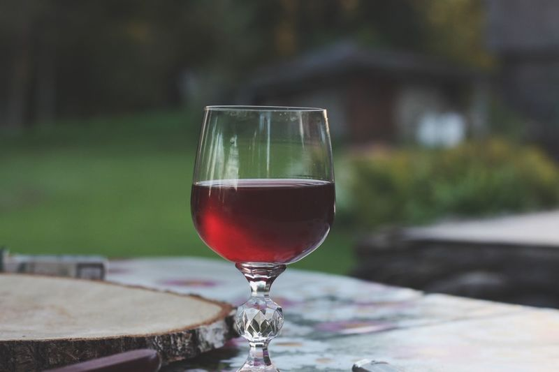 Wine on the table EyeEmNewHere Wining And Dining Wineglass Wine Drinking Glass Table Red Wine Food And Drink Drink Alcohol Outdoors EyeEmNewHere