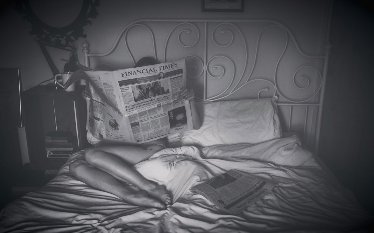 bed, bedroom, indoors, book, one person, sheet, text, real people, home interior, pillow, sitting, low section, close-up, day, people