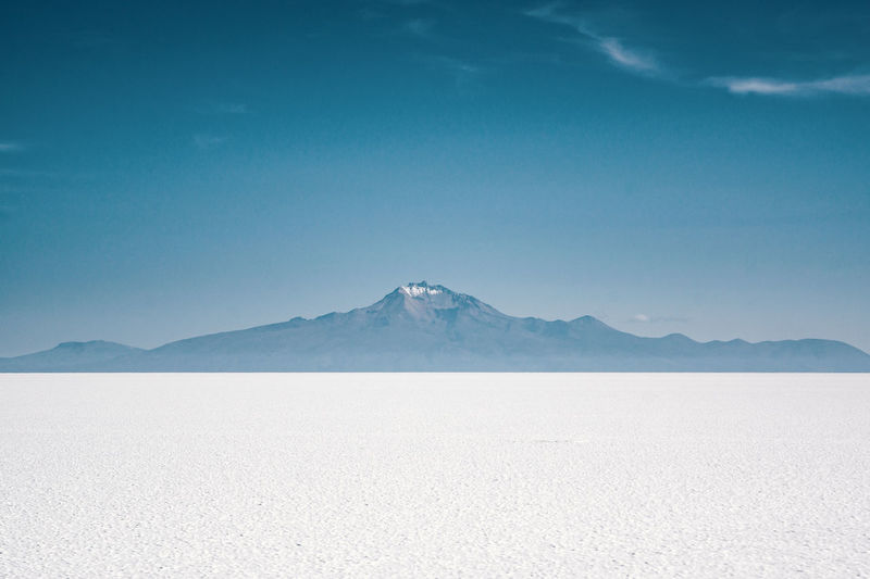 White Horizon Arid Climate Beauty In Nature Blue Day Environment Idyllic Land Landscape Mineral Minimalism Mountain Mountain Peak Mountain Range Nature No People Non-urban Scene Outdoors Salt Flat Scenics - Nature Sky Snowcapped Mountain Tranquil Scene Tranquility Travel Destinations Winter This Is Latin America Going Remote Visual Creativity The Great Outdoors - 2018 EyeEm Awards The Traveler - 2018 EyeEm Awards A New Perspective On Life Capture Tomorrow Springtime Decadence