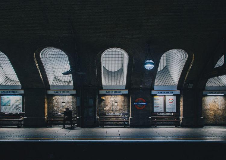 Illuminated railroad station in city