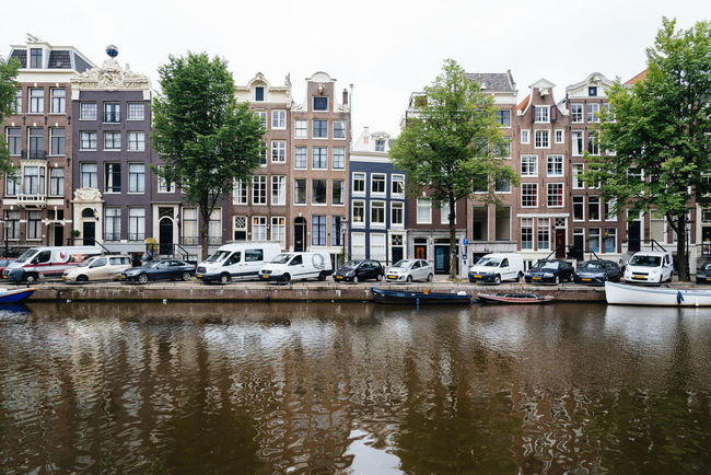 Amsterdam street scene Amsterdam Architecture Building Exterior Built Structure Canal Canals Canals And Waterways Cannabis City City City Life City Life Cityscape Day European  Mode Of Transport Nautical Vessel Outdoors Red Light District Reflection Street Tourism Travel Travel Destinations Water