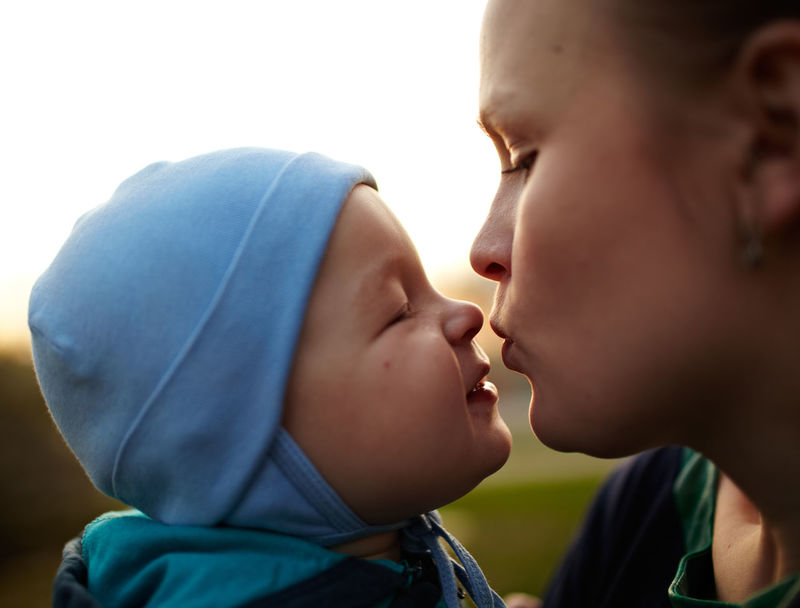 Adorable Ambience Baby Boy Caucasian Childhood Close-up Closeup Concentrate Cute Genetics Gentleness Humor Kiss Kissing Little Mom Mother Nose Smile Sunset Tender Tenderness Toddler  Young
