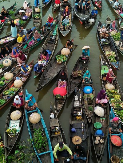 High Angle View Of People Selling Vegetables On Boats In Lake