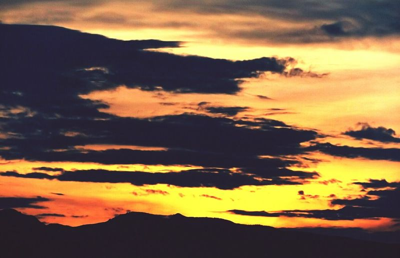 Scenic view of dramatic sky at sunset