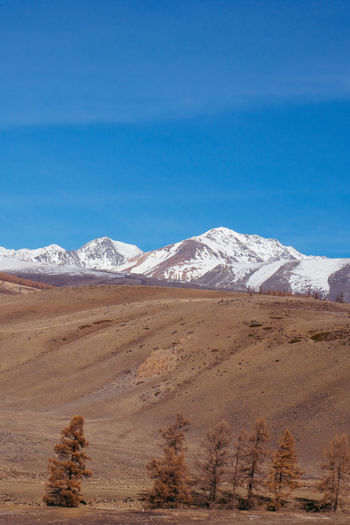 Arid Climate Beauty In Nature Blue Day Desert Landscape Mountain Mountain Range Nature No People Outdoors Physical Geography Salt - Mineral Scenics Sky Snow Tranquil Scene Tranquility