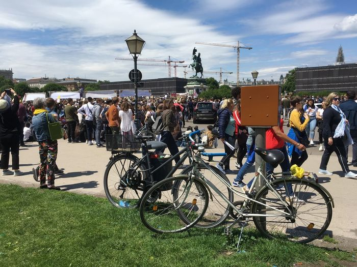 Bicycle Transportation Crowd Large Group Of People Group Of People Cloud - Sky Mode Of Transportation Real People Men Architecture Land Vehicle Nature Lifestyles Sky Building Exterior Built Structure Women Day City Outdoors