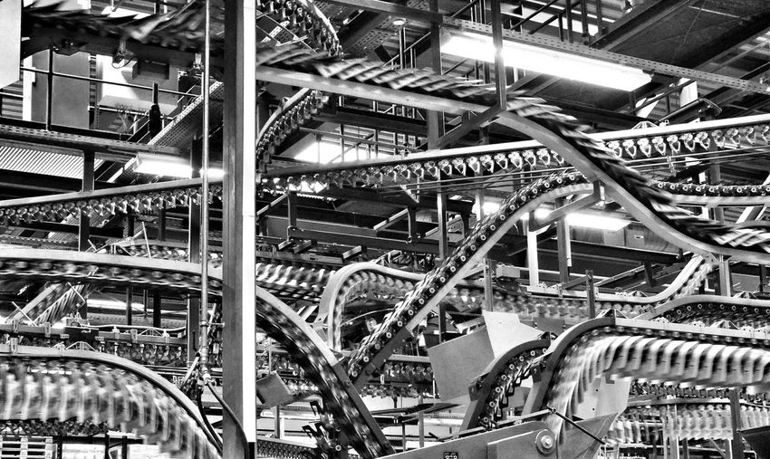 Blackandwhite Newspaper Printing Machine Snakes Lines & Curves Mass Media Production The Effect Of The Mass Media Is Not To Elicit Belief But To Maintain The Apparatus Of Addiction -Christopher Lasch