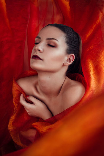 Lady in red. Fiery Beautiful Woman Makeup Lips Red Vibrant Conceptual Sensual_woman Closed Eyes Hands Skin Glowing Young Adult Contemplation Fashion Portrait Indoors  Relaxation Capture Tomorrow