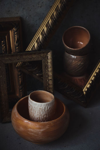 Ceramic kitchen bowls and cups in picture frames. Painting-look composed shots. Ode to clay. No People Still Life Close-up Ceramic Art Ceramics Tea Cup Teapot Picture Frame Paintings Art And Craft Kitchen Utensil Pottery Bowl Dish Handmade Hand Made Wall Art Rembrandt Light Crafted Beauty darkness and light Low Light Low Key High Angle View
