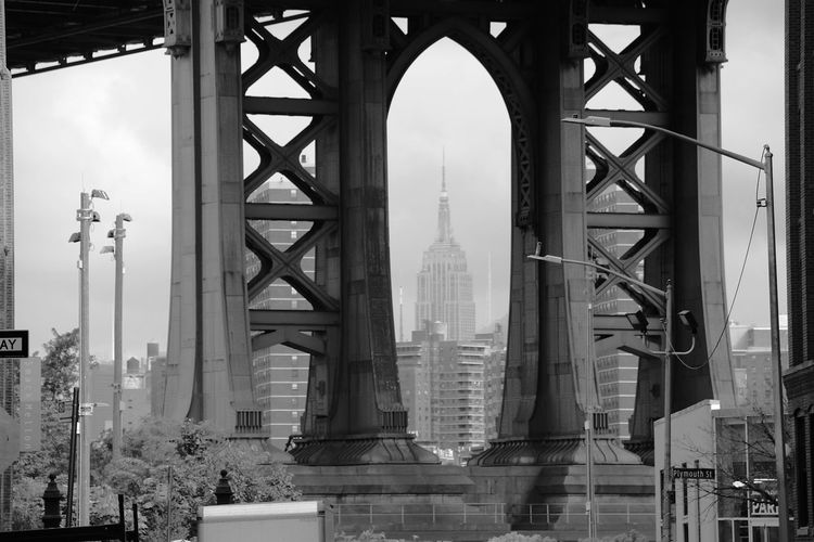 Architectural Column Architecture B&w Black And White Bridge Built Structure City Day DUMBO, Brooklyn Empire State Building Horizontal Low Angle View Modern No People Outdoors Sky Skyscraper Street Photography Streetphotography Tourism Travel Travel Destinations Monochrome Photography