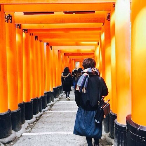 Japanese Temple Red Architecture Rear View Orange Color Real People Built Structure Group Of People Men Walking Clothing Day Building People