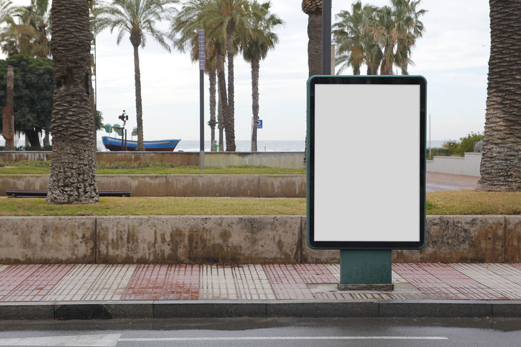 Blank billboard mock up Advertising Architecture Billboards City Advertisement Billboard Blank Commercial Day Empty Foothpath Mock Up Mockup Nature Nobody Outdoors Palm Tree Sea Street Tree