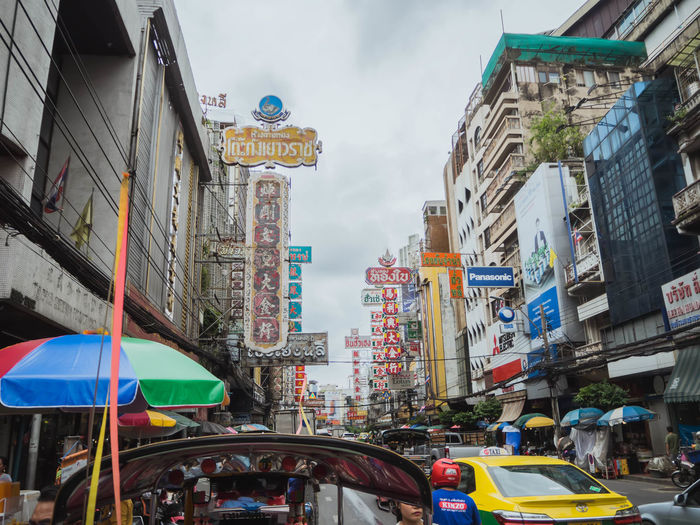Architecture Building Building Exterior Built Structure Car Chinatown, Bangkok City City Life City Street Communication Day Incidental People Land Vehicle Mode Of Transportation Motor Vehicle Outdoors Road Sign Sky Street Text Transportation