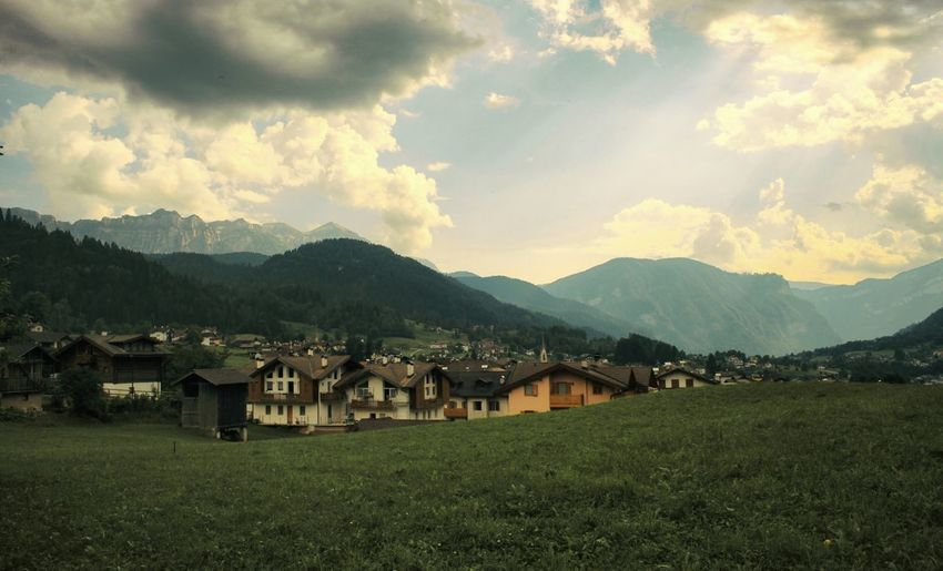 Spiritual sky in the mountain village Dolomites, Italy Colors Light And Shadow Light Sunlight Beauty In Nature Street House Village Grass Pathway Cloud - Sky Sky City Mountain Agriculture Rural Scene Rice Paddy Hut Social Issues Sky Architecture Grass Landscape