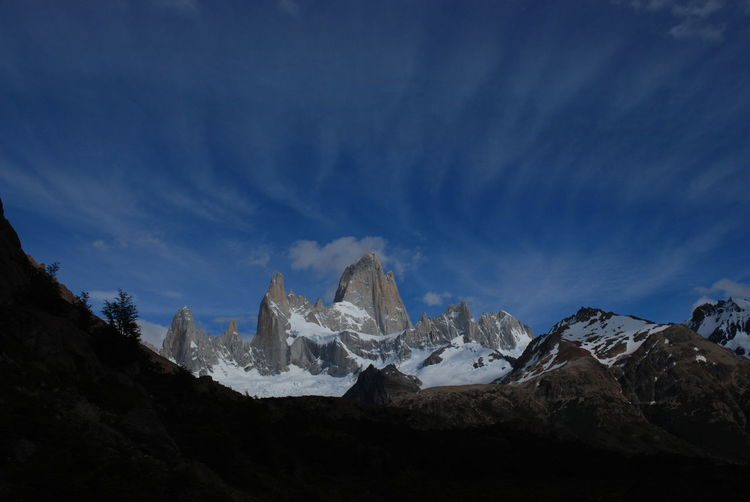 Smoke over el Chaltén (Fitz Roy) Andes Argentina Blue Sky Clouds Cordillera De Los Andes Fitz Roy Fitzroy Landscape Majestic Mountain Mountain Range Patagonia Sky Snow Travel Photography Traveling Voyages Landscapes With WhiteWall Miles Away Perspectives On Nature Shades Of Winter This Is Latin America
