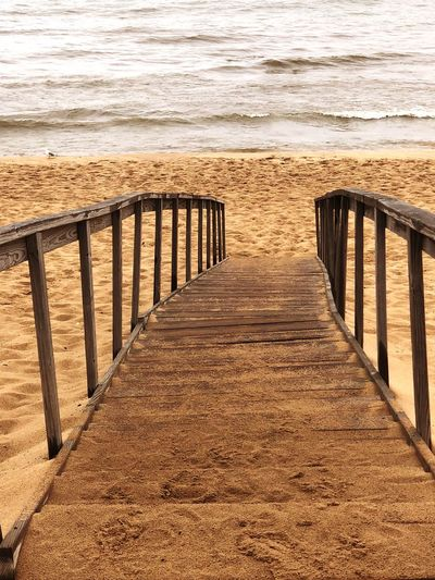 Beach Land Sea Sand Water Railing Nature Tranquility No People Tranquil Scene Scenics - Nature Beauty In Nature Wood - Material Sunlight Outdoors Day Horizon Over Water Wave