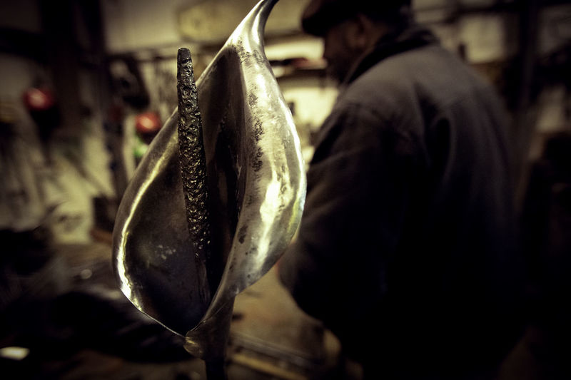 Rear view of man holding fish at market