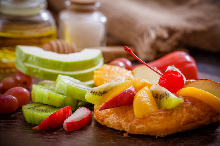 Close-up of fruits in plate on table