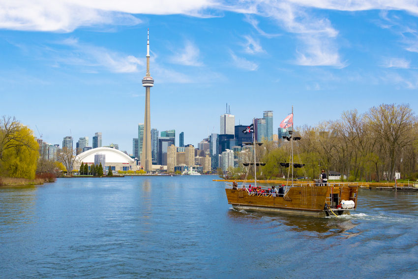 Toronto skyline including CN Tower. The landmark is a major tourist attraction of Canada's financial capital Architecture Beautiful Canada City Cloud - Sky CN Tower Day Landmark Tower Outdoors Sky And Clouds Tall - High Toronto Tourism Tourism Destination Tourist Attraction  Travel Destinations Urban Urban Landscape Water