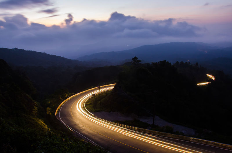 Sunrise Beauty In Nature Curve Driving Dusk Landscape Mountain Nature Night Outdoors Sky Sunrise Sunset Transportation Travel Valley Winding Road