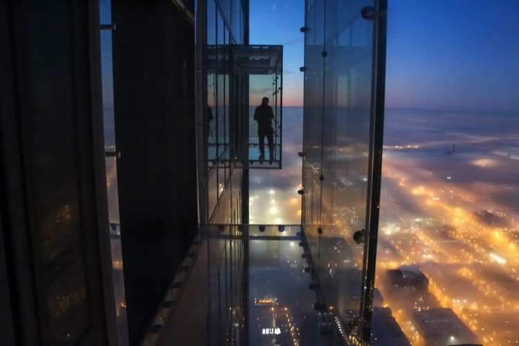 Sky high Chicago Glass - Material Reflection Window Real People Sky Transparent One Person Cloud - Sky Architecture Built Structure Outdoors Men Glass Silhouette Adult Chicago Architecture Architectural Column Sunrise Skyscraper Clouds And Sky Urban Skyline Cityscape Landscape Fog