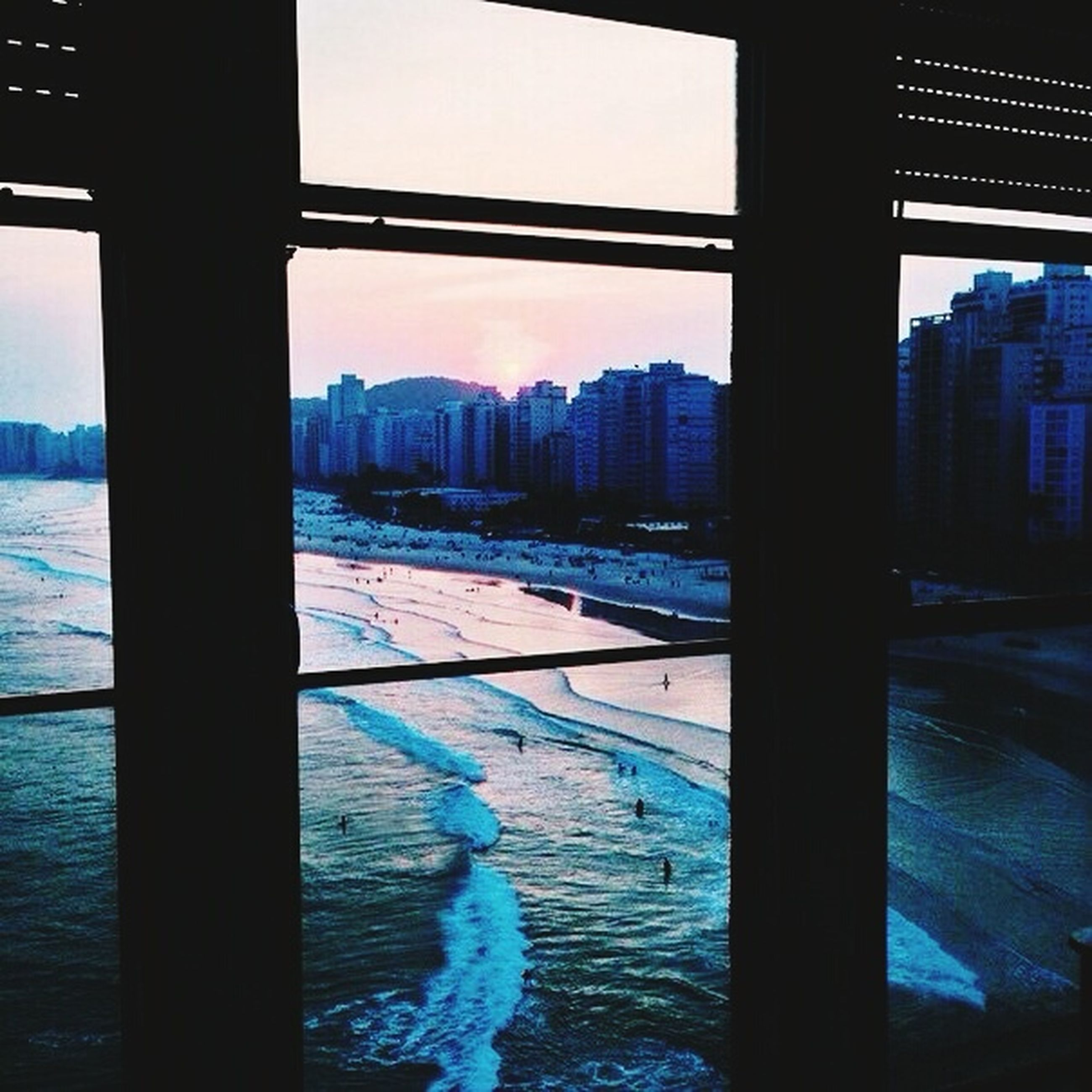architecture, built structure, water, building exterior, city, sea, river, waterfront, bridge - man made structure, sky, cityscape, connection, sunset, transportation, rippled, bridge, reflection, dusk, illuminated, travel destinations