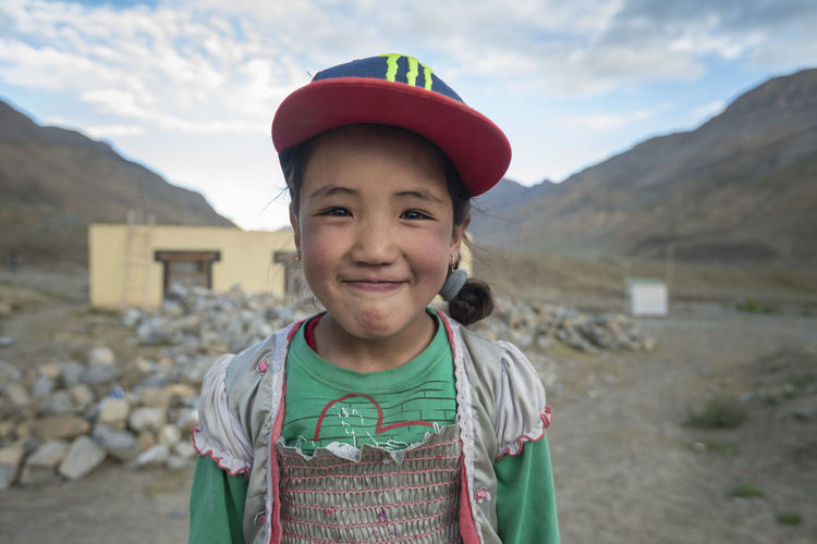 Portrait of smiling boy standing on mountain