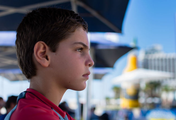 Profile View Of Boy At Beach