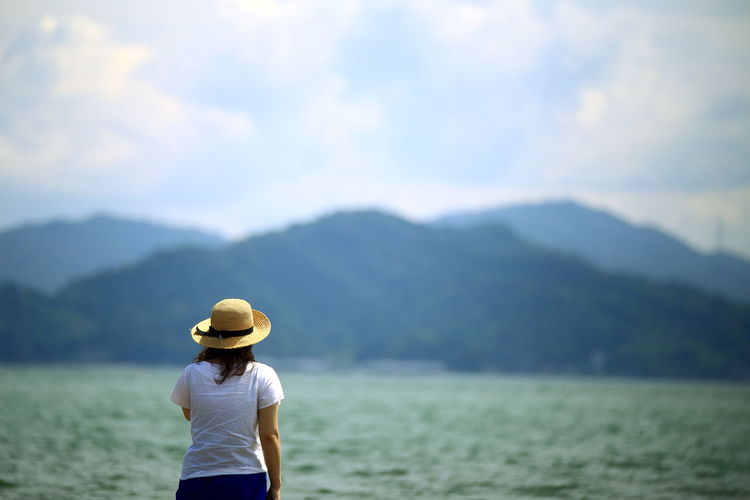 Beauty In Nature Casual Clothing Cloud - Sky Day EyeEm Gallery Focus On Foreground Hat Landscape Leisure Activity Lifestyles Mountain Mountain Range Nature Non-urban Scene Outdoors People Rear View Scenics Sky Standing Tranquil Scene Tranquility Vacations Women Be. Ready.