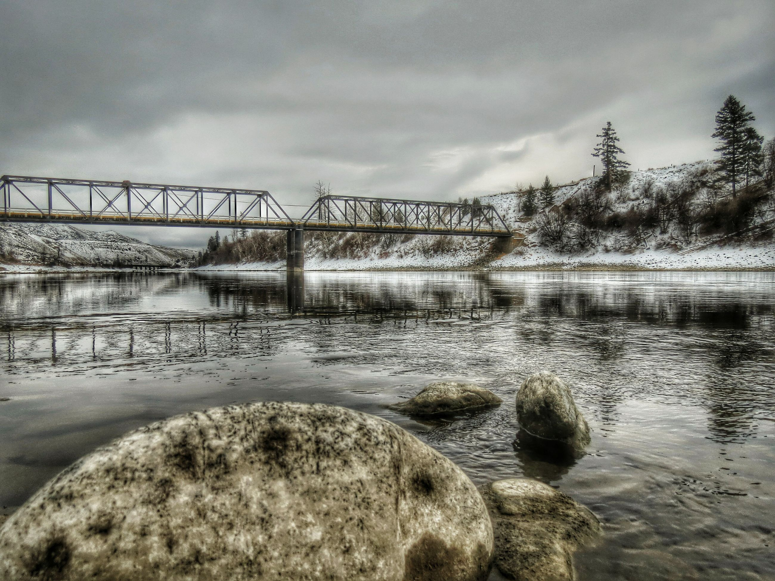 water, sky, cloud - sky, cloudy, river, connection, bridge - man made structure, tranquility, nature, built structure, tranquil scene, lake, cloud, scenics, weather, reflection, architecture, beauty in nature, rock - object, overcast