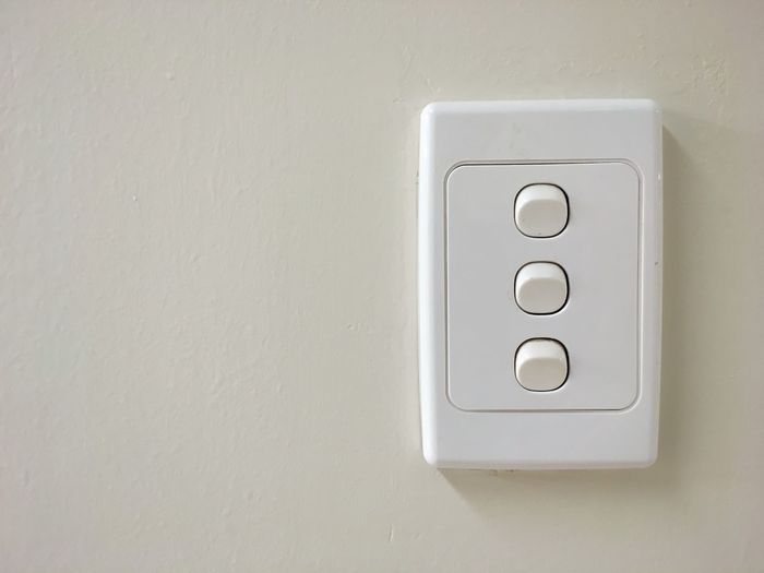 Light switches. Electricity  Wall - Building Feature Light Switch Indoors  Push Button Switch No People Close-up Choice Choices Decisions Three