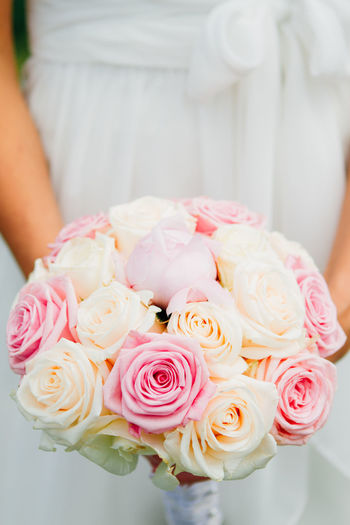 Wedding Bouquet Bouquet Bride Celebration Celebration Event Ceremony Close-up Flower Flower Head Focus On Foreground Fragility Freshness Holding Indoors  Life Events Midsection One Person Petal Pink Color Rose - Flower Sweet Food Wedding Wedding Cake Wedding Ceremony Wedding Dress Women