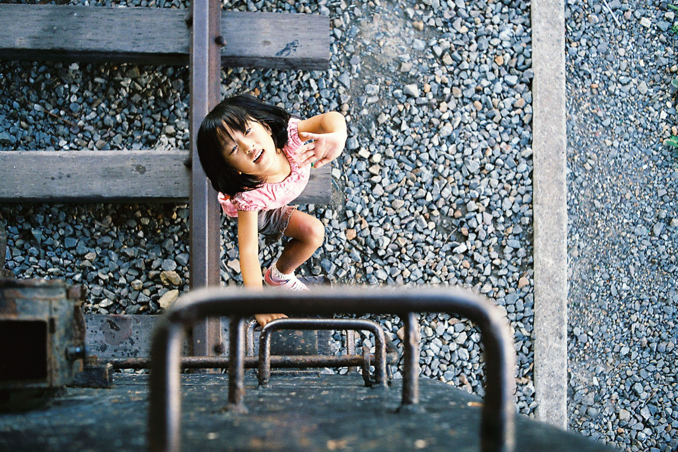 metal, childhood, day, railroad track, high angle view, chain, outdoors, transportation, metallic, full length, railing, playground, bench, rusty, abandoned, street, sitting, no people, sunlight, protection