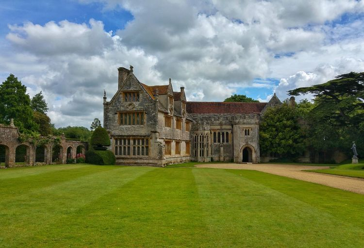 view to Athelhampton House in Dorset Castle Architecture Beauty In Nature Building Exterior Built Structure Cloud - Sky Clouds And Sky Day Fame Grass Lawn Nature No People Outdoors Sky Tree