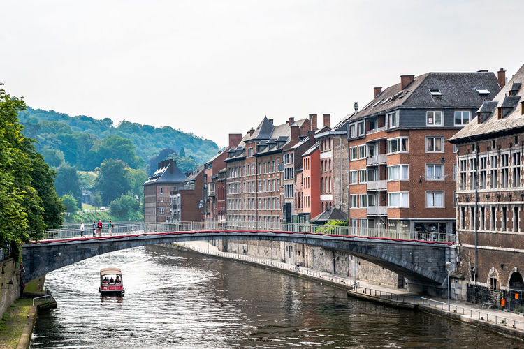 Architecture Bridge Bridge - Man Made Structure Building Exterior Built Structure City Connection Day Mode Of Transportation Mountain Nature Nautical Vessel No People Outdoors Passenger Craft River Sky Transportation Travel Travel Destinations Water Waterfront