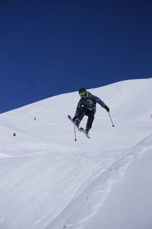 Skiing in Montgenevre Skiing Adventure Cold Temperature Full Length Holiday Leisure Activity Lifestyles Mountain One Person Real People Ski-wear Skiing Snow Snowcapped Mountain Sport Trip Unrecognizable Person Vacations Warm Clothing White Color Winter Winter Sport