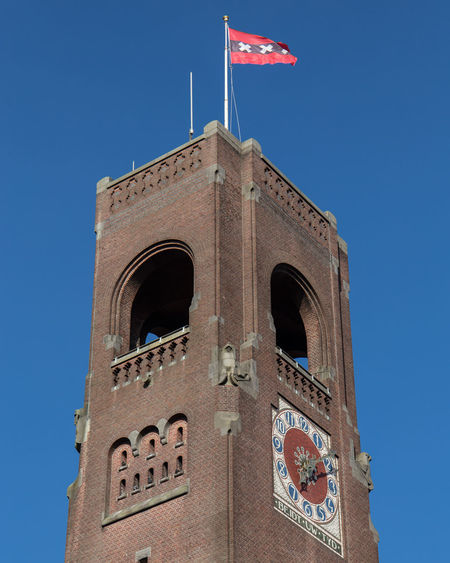 Amsterdam Netherlands Architecture Beurs Van Berlage Blue Building Building Exterior Built Structure Clear Sky Clock Day Dutch Flag History Holland Low Angle View Nature No People Outdoors Patriotism Sky Sunlight The Past Tower Travel Travel Destinations Xxxyedcrxxx