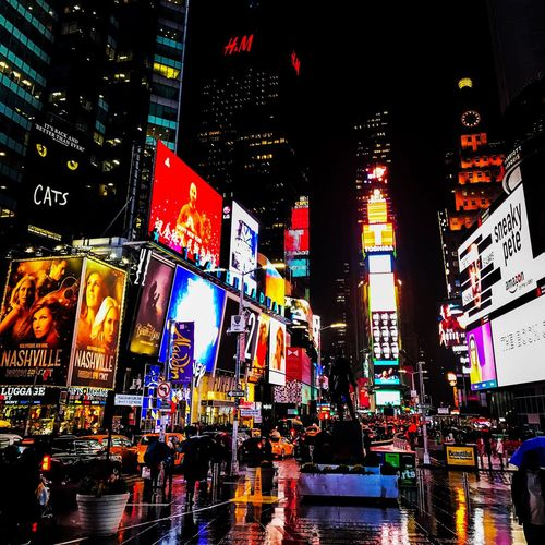 NY New York Times Square Manhatten USA Colour Lights Neon Advertising Tourist Non-stop Busy Rain And Reflections
