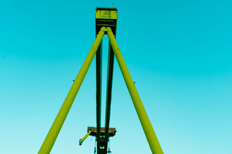 Low angle view of yellow structure against blue sky