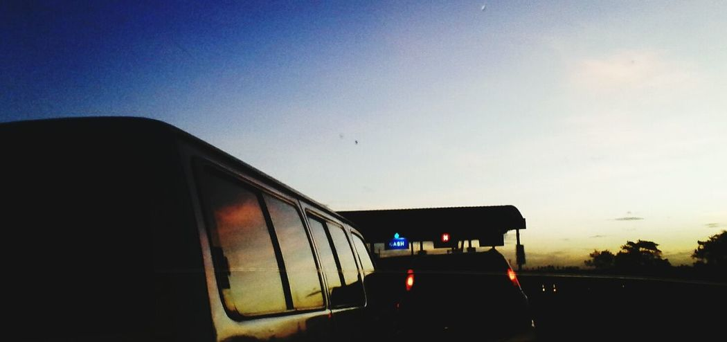 Coz its always a good time:) Tollgate Paytime TriptoTernate Sunset Silhouettes FrontSeatShot nyt nyt eyeEm