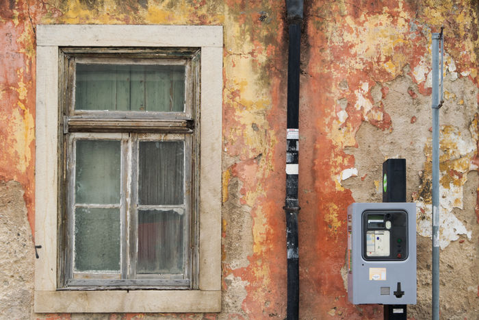 View of Amadora, suburb of Lisbon in Portugal Abandoned Amadora Architecture Building Exterior Built Structure Close-up Damaged Day No People Outdoors Parking Meter Portugal Weathered Window