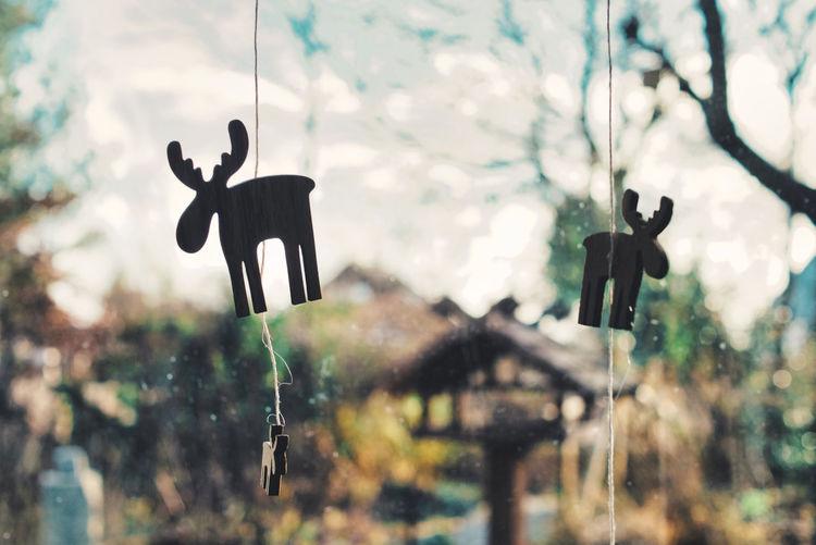 Close-up of figure of elk hanging on window