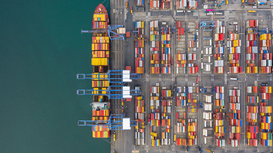 Aerial view of multi colored cargo container by lake