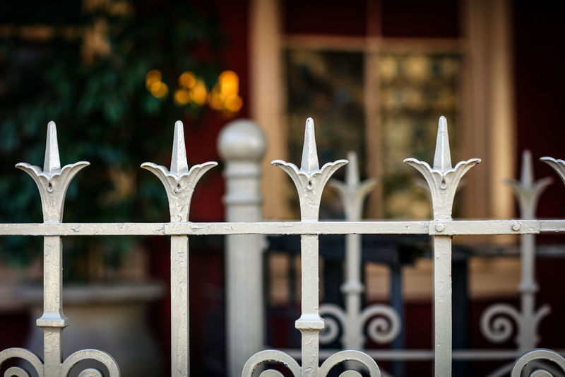 Fence Fence Ironwork  Boundary Metal Metal Fence Barrier Focus On Foreground Security Safety No People Protection Close-up Day Sharp Outdoors Architecture Selective Focus Built Structure Wrought Iron Street