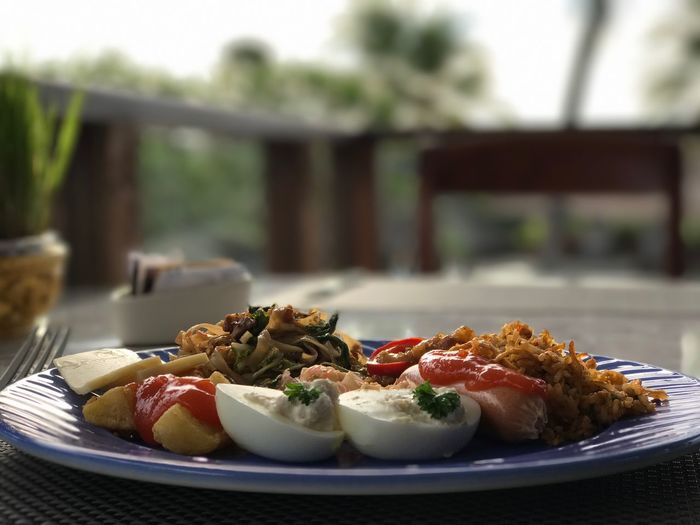 Today's breakfast, Kamandalu. Table Food And Drink Food Close-up Plate No People Ready-to-eat Outdoors Healthy Eating Day Freshness Roast Chicken Greek Salad (null)Bali EyeEm Breakfast