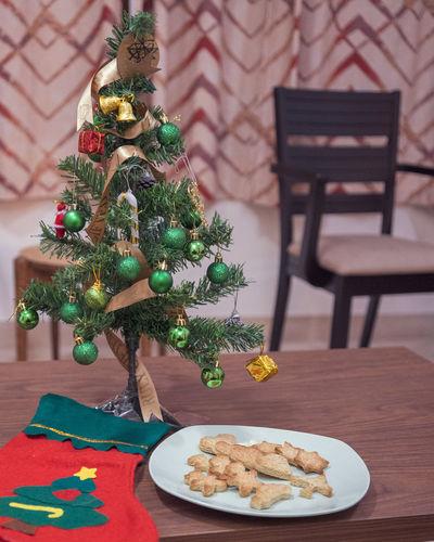 Christmas tree on table at home
