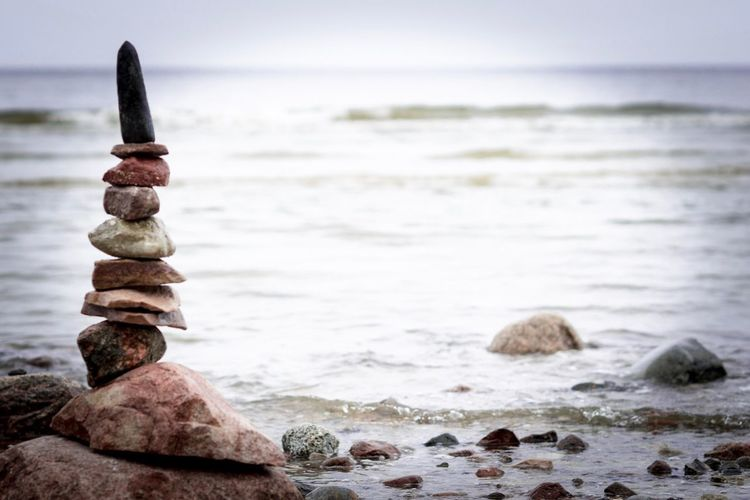 Sea Water Rock - Object Nature Horizon Over Water Outdoors Focus On Foreground Beauty In Nature Balance No People Pebble Day Scenics Beach Sky Groyne Animal Themes Close-up Perching